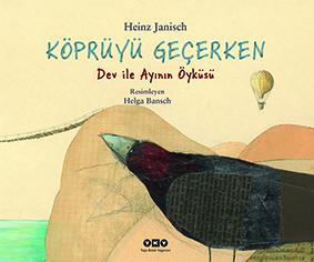 Köprüyü Geçerken Dev ile Ayının Öyküsü  Heinz Janisch Resimleyen: Helga Bansch  Çeviren: Serhat Yalçın Yapı Kredi Yayınları, 32 sayfa